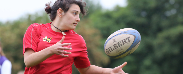 Woman catches rugby ball