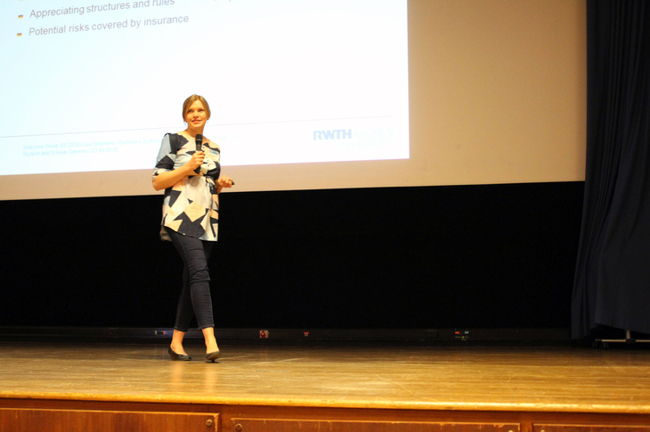 Woman on a stage giving a presentation