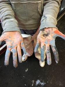 Hands full of paint
