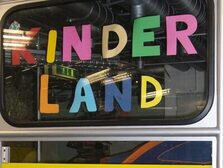 "The word ""Kinderland"" cut out of paper"